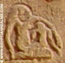Oud-Egyptisch hiëroglief van een vrouw met kind.