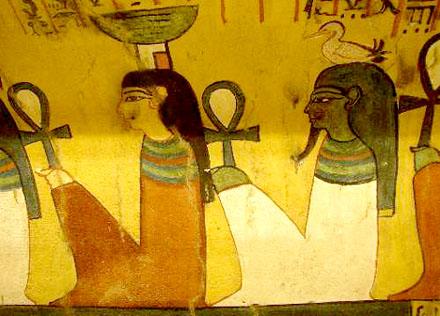 Geb gehurkt afgebeeld naast Nebet-Het op een muur van een tombe.