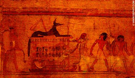 Mannen trekken een slee met huis waarop Upuaut ligt.