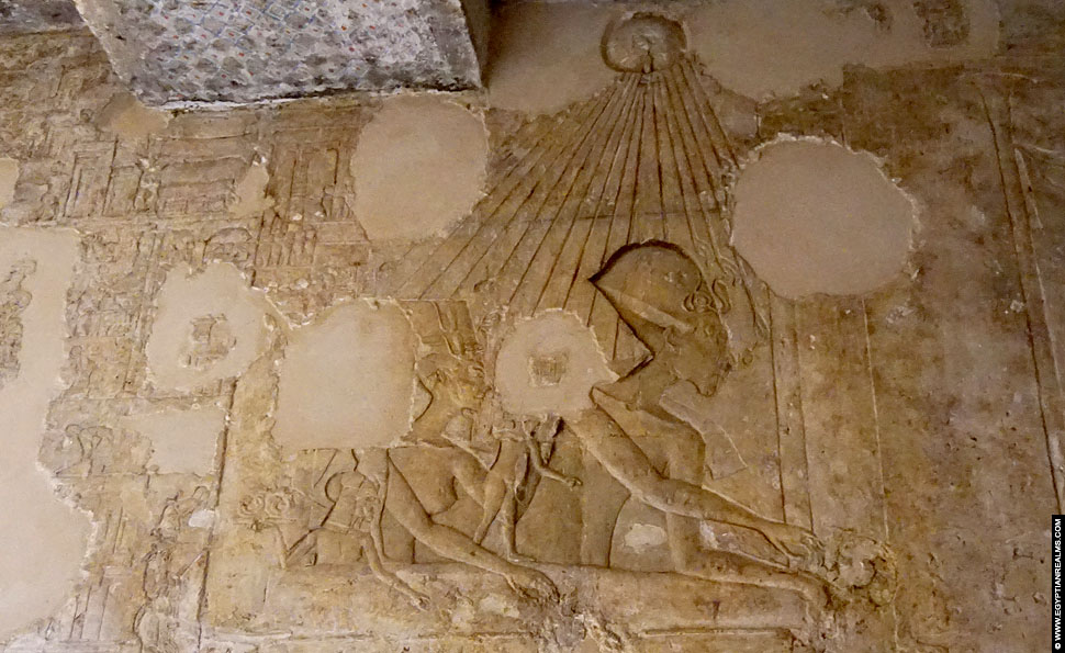 Relief of Nefertiti and Akhenten in the tomb of Ay at Amarna.