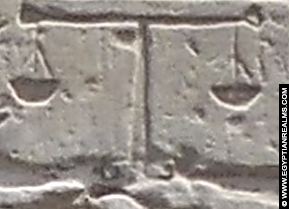 Ancient Egyptian hieroglyph of a scale.