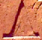Ancient Egyptian hieroglyph of a pyramid.
