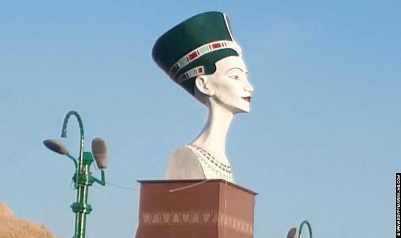 Large statue of queen Nefertiti at Minya