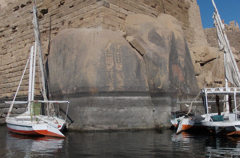 Ancient Egyptian stone carvings on rock at Aswan